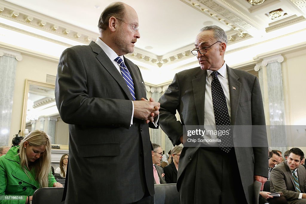Metropolitan Transportation Authority Chairman and CEO Joseph Lhota (L) talks with U.S. Sen. <a gi-track='captionPersonalityLinkClicked' href=/galleries/search?phrase=Charles+Schumer&family=editorial&specificpeople=171249 ng-click='$event.stopPropagation()'>Charles Schumer</a> (D-NY) before a Senate Surface Transportation and Merchant Marine Infrastructure, Safety, and Security Subcommittee hearing on 'Superstorm Sandy: The Devastating Impact on the Nation's Largest Transportation Systems.' December 6, 2012 in Washington, DC. Lhota, Shumer and others testified before the subcommittee about the need for more federal dollars for Superstorm Sandy recovery.