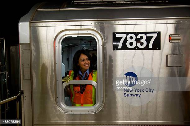 A Metropolitan Transportation Authority train conductor looks out of a window on a 7 train during the opening of the Hudson Yards subway station in...