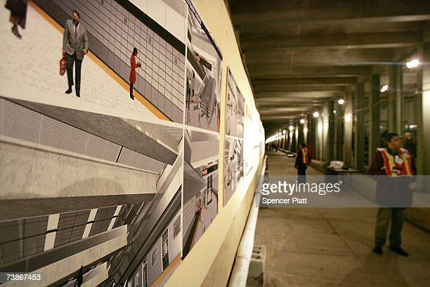 Metropolitan Transportation Authority worker stands beside proposed designs for a completed subway platform in an underground tunnel of the...
