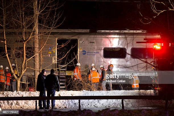 Metropolitan Transportation Authority workers and other responders work at the scene of a train crash on February 3 2015 in Valhalla New York A...