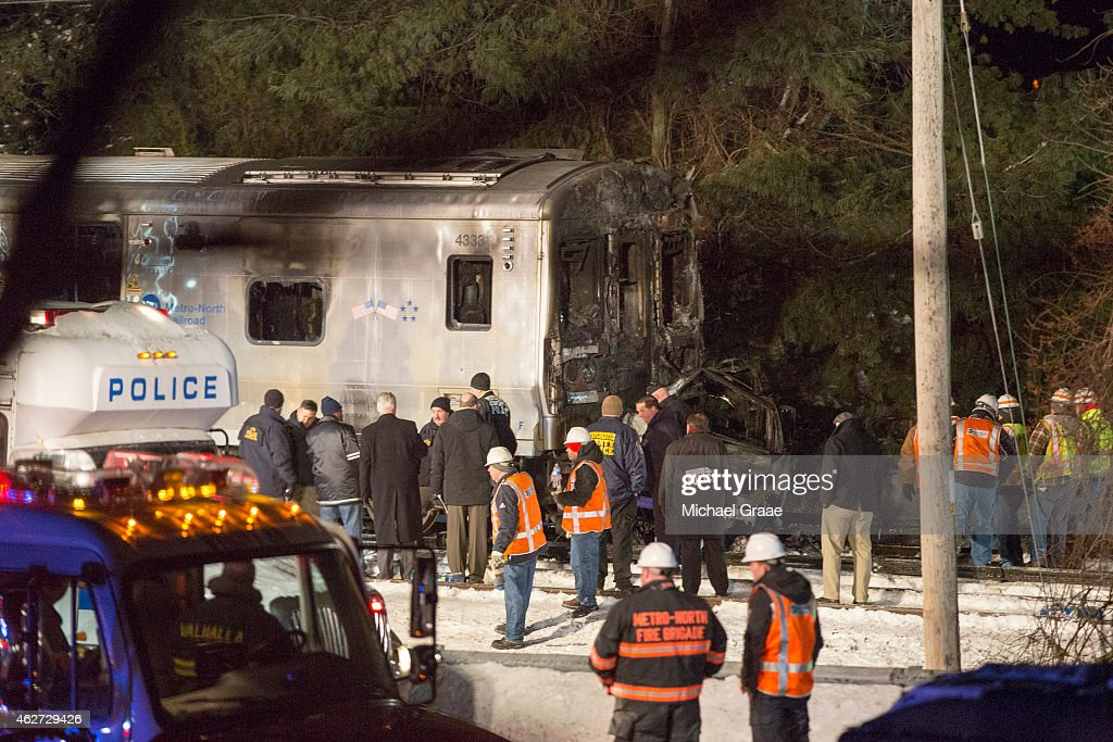 Metropolitan Transportation Authority workers and police investigate a MetroNorth train crash on February 3 2015 in Valhalla New York A MetroNorth...