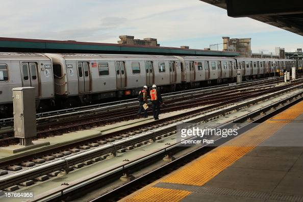 Metropolitan Transportation Authority workers walk the tracks two days after a man was pushed to his death in front of a train on December 5 2012 in...