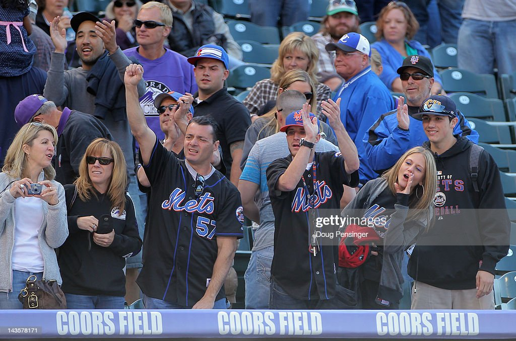 Mets fans celebrate the New York Mets victory over the Colorado Rockies at Coors Field on April 29, 2012 in Denver, Colorado. The Mets defeated the Rockies 6-5 in 11 innings.