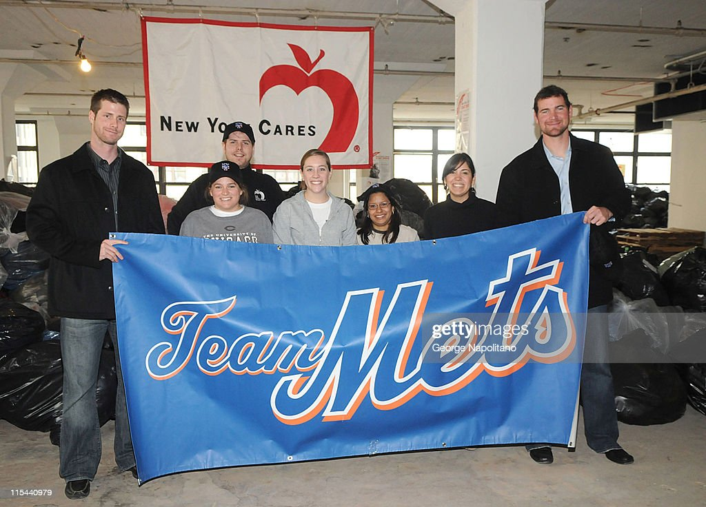 Mets pitcher John Maine, NY Cares Director Wes Moe, volunteers Hannah Bachman, Laura Dudney, Maura Martinez and Lucy Phillipe and Mets pitcher Mike Pelfrey at the 20th Annual New York Cares Coat Drive at their warehouse on December 18, 2008 in New York City.