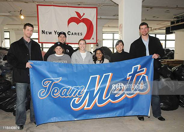 Mets pitcher John Maine NY Cares Director Wes Moe volunteers Hannah Bachman Laura Dudney Maura Martinez and Lucy Phillipe and Mets pitcher Mike...