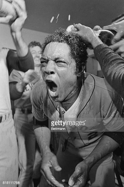 Met's Willie Mays gets champagne poured over him during a jubilant celebration in the New York dressing room here after the Mets clinched the...