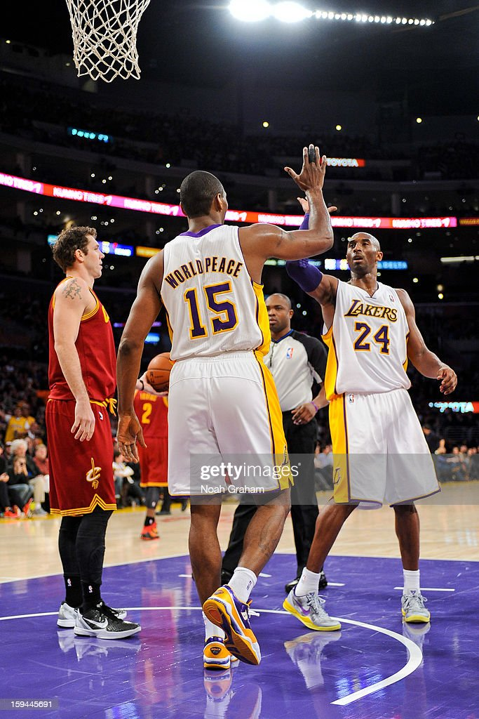 Metta World Peace #15 and Kobe Bryant #24 of the Los Angeles Lakers celebrate during their game against the Cleveland Cavaliers at Staples Center on January 13, 2013 in Los Angeles, California.