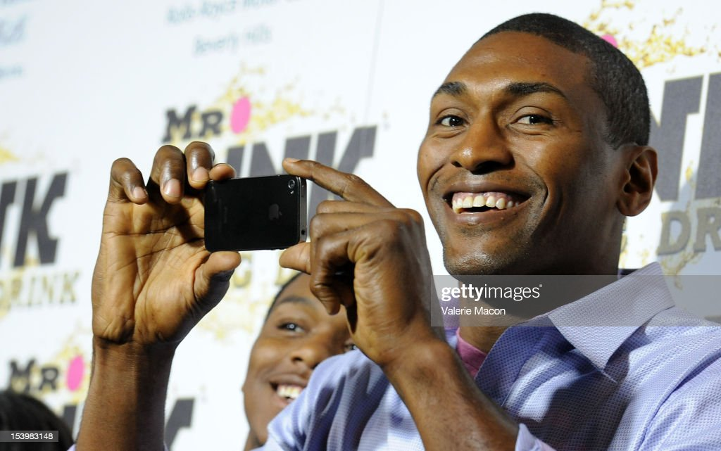 Metta World Peace arrives at Mr. Pink Ginseng Drink Launch Party on October 11, 2012 in Beverly Hills, California.