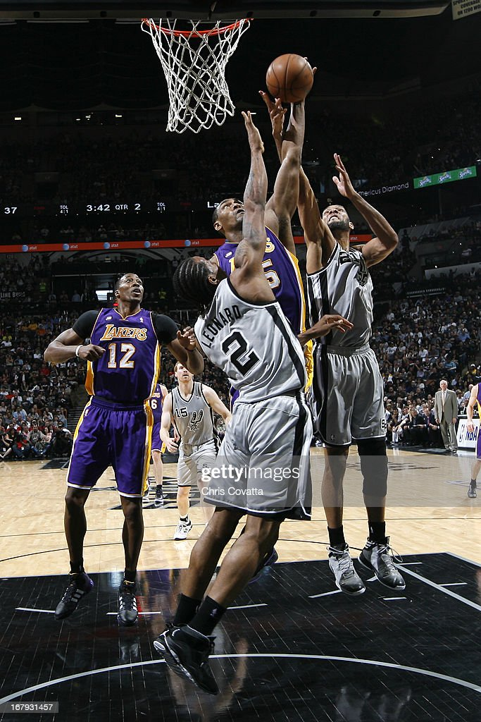 Metta World Peace #15 of the Los Angeles Lakers and <a gi-track='captionPersonalityLinkClicked' href=/galleries/search?phrase=Kawhi+Leonard&family=editorial&specificpeople=6691012 ng-click='$event.stopPropagation()'>Kawhi Leonard</a> #2 of the San Antonio Spurs go up for a rebound in Game One of the 2013 NBA Playoffs at the AT&T Center on April 21, 2013 in San Antonio, Texas.