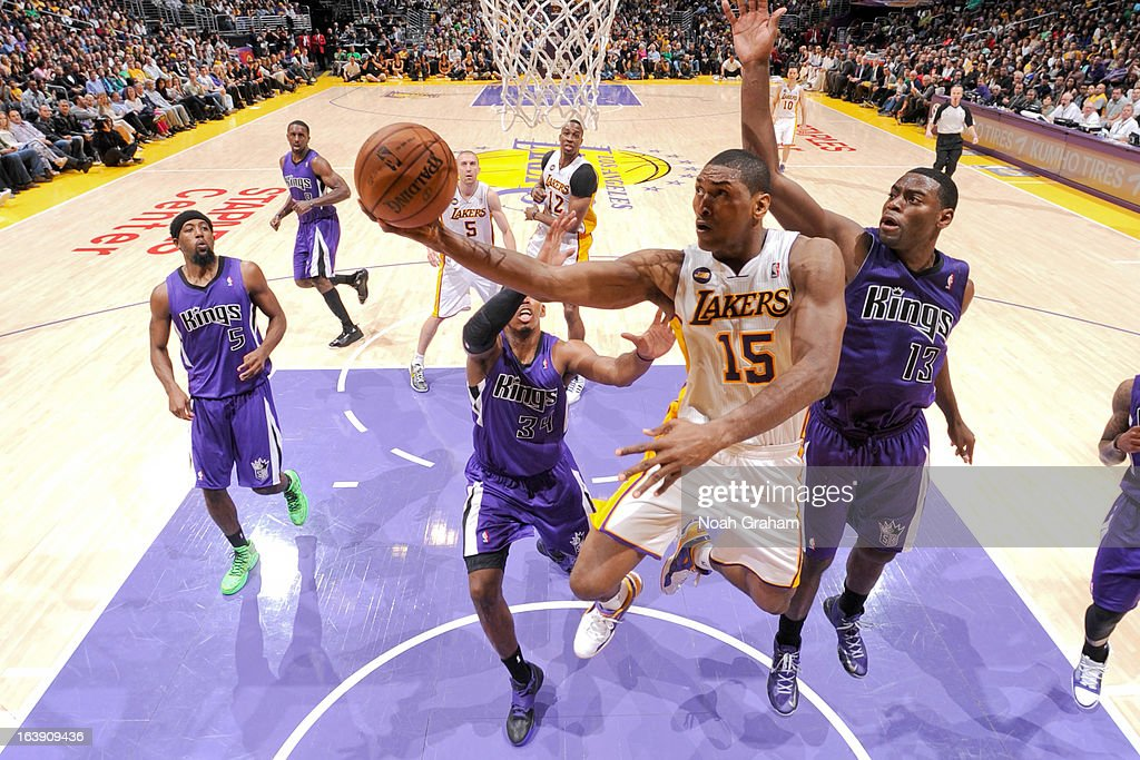 Metta World Peace #15 of the Los Angeles Lakers attempts a layup against Jason Thompson #34 and <a gi-track='captionPersonalityLinkClicked' href=/galleries/search?phrase=Tyreke+Evans&family=editorial&specificpeople=4851025 ng-click='$event.stopPropagation()'>Tyreke Evans</a> #13 of the Sacramento Kings at Staples Center on March 17, 2013 in Los Angeles, California.