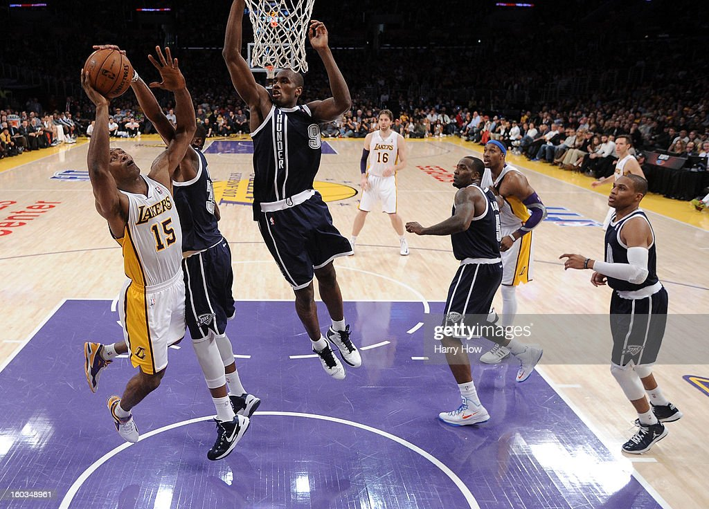Metta World Peace #15 of the Los Angeles Lakers attempts a layup in front of Kevin Durant #35, Serge Ibaka #9, Kendrick Perkins #5 and Russell Westbrook #0 of the Oklahoma City Thunder at Staples Center on January 27, 2013 in Los Angeles, California.