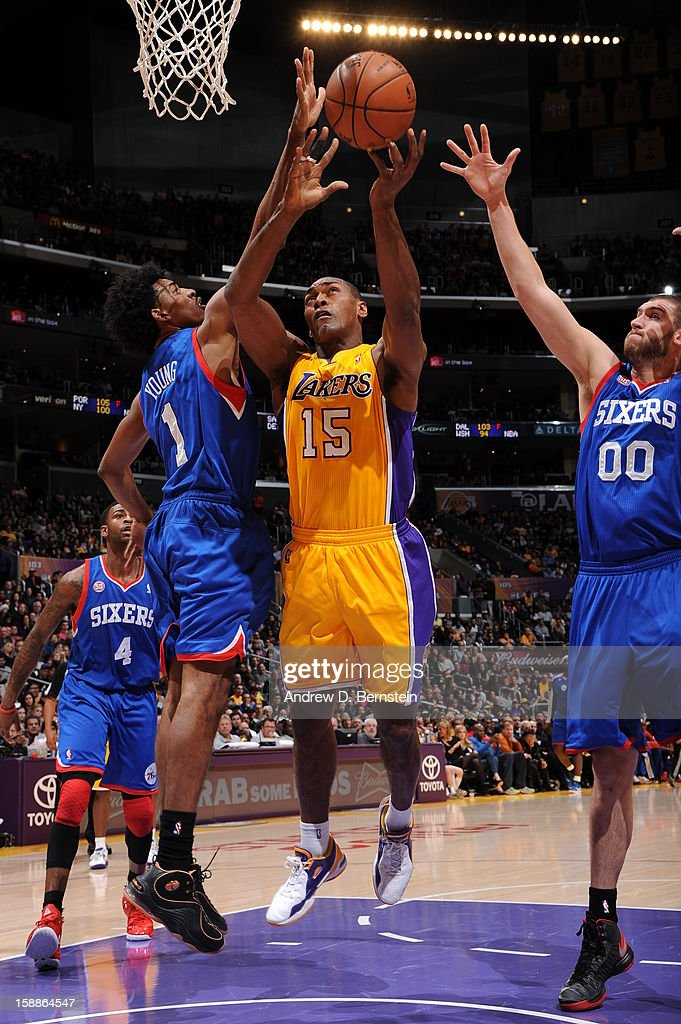 Metta World Peace #15 of the Los Angeles Lakers attempts a shot against Nick Young #1 and Spencer Hawes #00 of the Philadelphia 76ers at Staples Center on January 1, 2013 in Los Angeles, California.