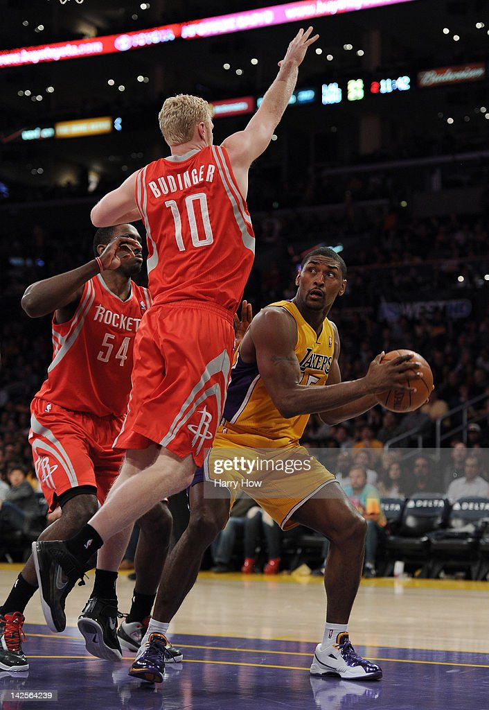 Metta World Peace #15 of the Los Angeles Lakers attempts a shot on <a gi-track='captionPersonalityLinkClicked' href=/galleries/search?phrase=Chase+Budinger&family=editorial&specificpeople=3847600 ng-click='$event.stopPropagation()'>Chase Budinger</a> #10 of the Houston Rockets at Staples Center on April 6, 2012 in Los Angeles, California.