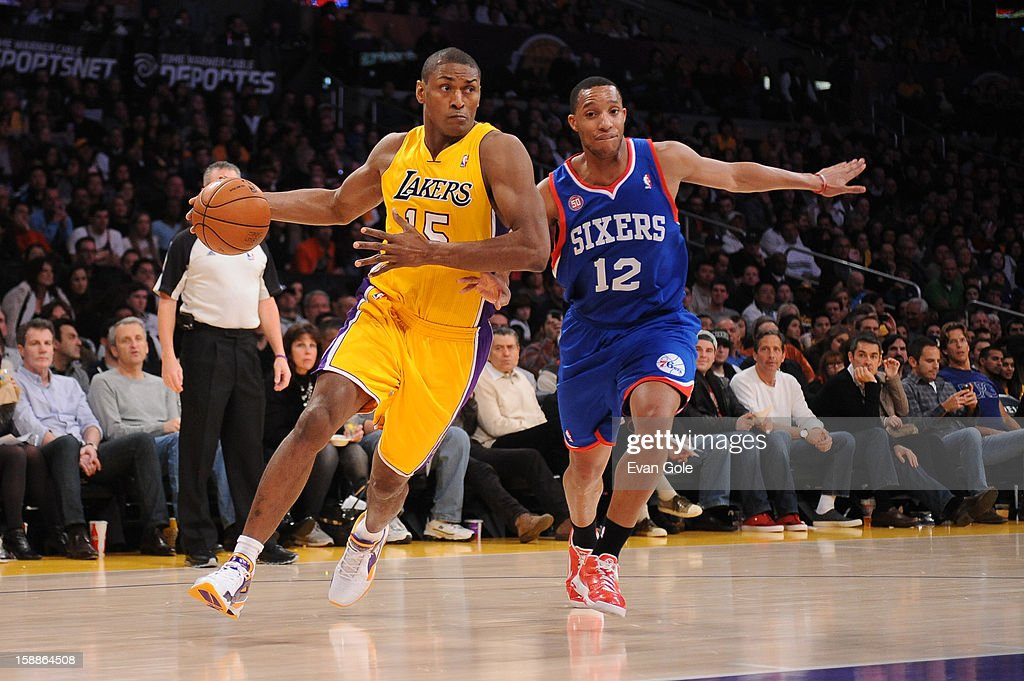 Metta World Peace #15 of the Los Angeles Lakers dribbles past Evan Turner #12 of the Philadelphia 76ers at Staples Center on January 1, 2013 in Los Angeles, California.
