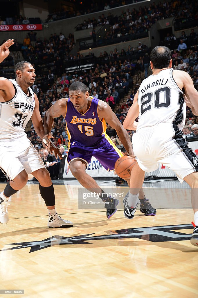 Metta World Peace #15 of the Los Angeles Lakers drives against Boris Diaw #33 and Manu Ginobili #20 of the San Antonio Spurs during the game between the Los Angeles Lakers and the San Antonio Spurs on January 9, 2013 at the AT&T Center in San Antonio, Texas.