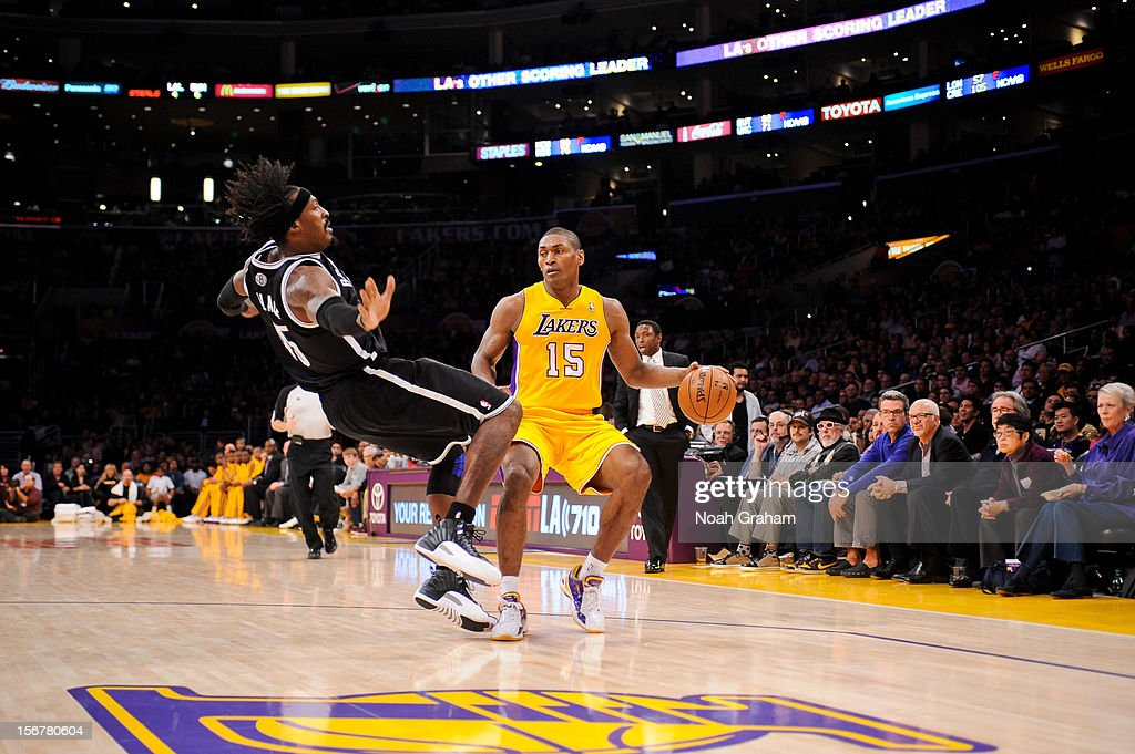 Metta World Peace #15 of the Los Angeles Lakers drives against <a gi-track='captionPersonalityLinkClicked' href=/galleries/search?phrase=Gerald+Wallace&family=editorial&specificpeople=202117 ng-click='$event.stopPropagation()'>Gerald Wallace</a> #45 of the Brooklyn Nets at Staples Center on November 20, 2012 in Los Angeles, California.