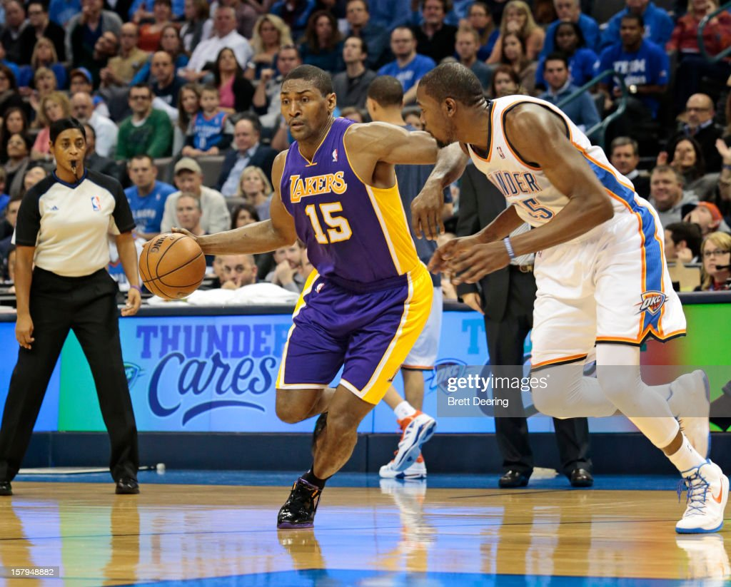 Metta World Peace #15 of the Los Angeles Lakers drives on <a gi-track='captionPersonalityLinkClicked' href=/galleries/search?phrase=Kevin+Durant&family=editorial&specificpeople=3847329 ng-click='$event.stopPropagation()'>Kevin Durant</a> #35 of the Oklahoma City Thunder December 7, 2012 at Chesapeake Energy Arena in Oklahoma City, Oklahoma. Oklahoma City defeated Los Angeles 114-108.