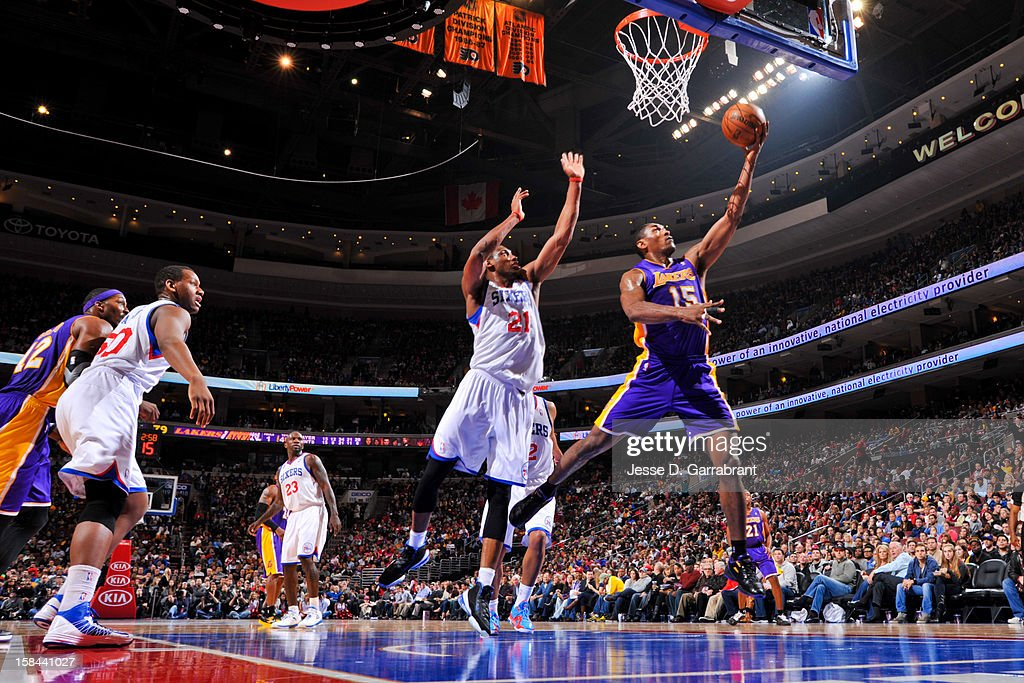 Metta World Peace #15 of the Los Angeles Lakers drives to the basket against Thaddeus Young #21 of the Philadelphia 76ers at the Wells Fargo Center on December 16, 2012 in Philadelphia, Pennsylvania.