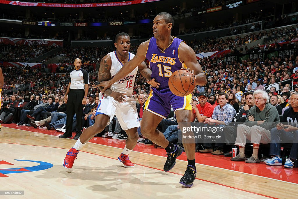 Metta World Peace #15 of the Los Angeles Lakers drives to the basket against Eric Bledsoe #12 of the Los Angeles Clippers at Staples Center on January 4, 2013 in Los Angeles, California.