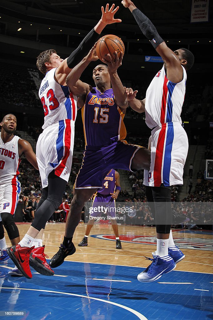 Metta World Peace #15 of the Los Angeles Lakers drives to the basket against Jonas Jerebko #33 of the Detroit Pistons on February 3, 2013 at The Palace of Auburn Hills in Auburn Hills, Michigan.