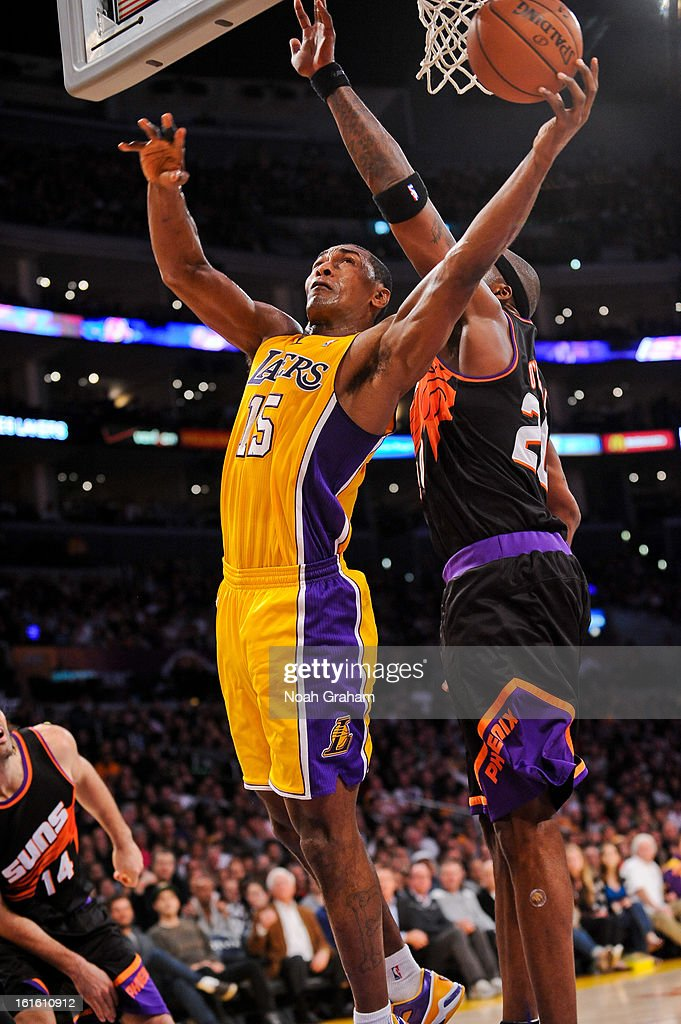 Metta World Peace #15 of the Los Angeles Lakers drives to the basket against Jermaine O'Neal #20 of the Phoenix Suns at Staples Center on February 12, 2013 in Los Angeles, California.