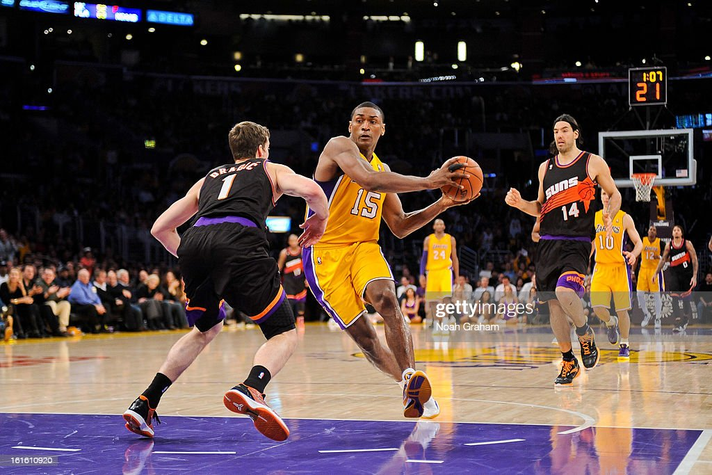 Metta World Peace #15 of the Los Angeles Lakers drives to the basket against Goran Dragic #1 of the Phoenix Suns at Staples Center on February 12, 2013 in Los Angeles, California.