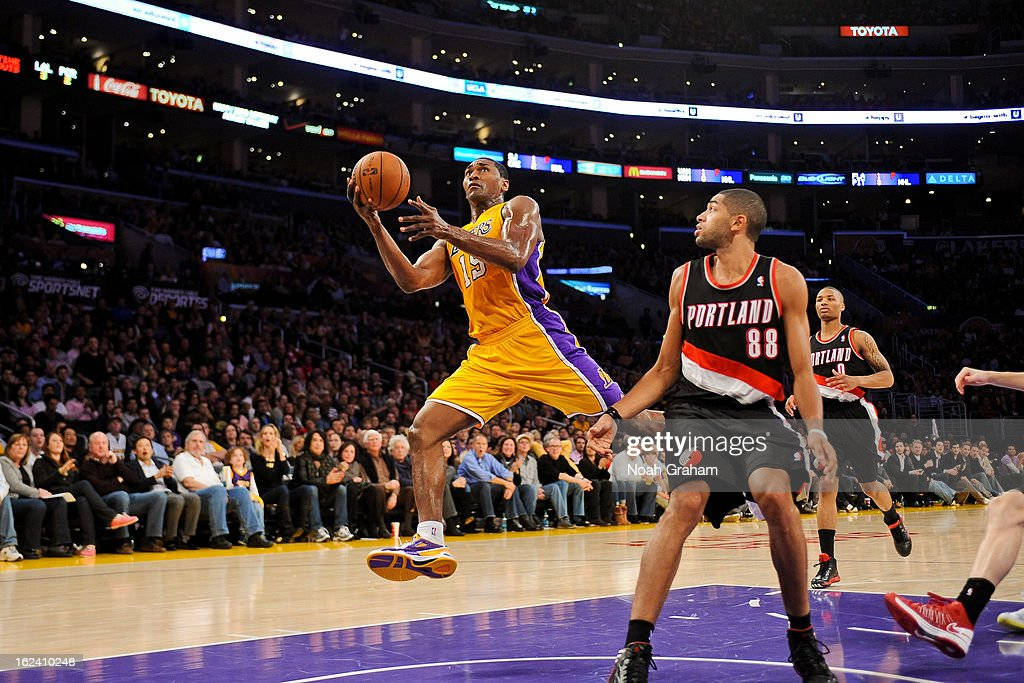 Metta World Peace #15 of the Los Angeles Lakers drives to the basket against <a gi-track='captionPersonalityLinkClicked' href=/galleries/search?phrase=Nicolas+Batum&family=editorial&specificpeople=3746275 ng-click='$event.stopPropagation()'>Nicolas Batum</a> #88 of the Portland Trail Blazers at Staples Center on February 22, 2013 in Los Angeles, California.