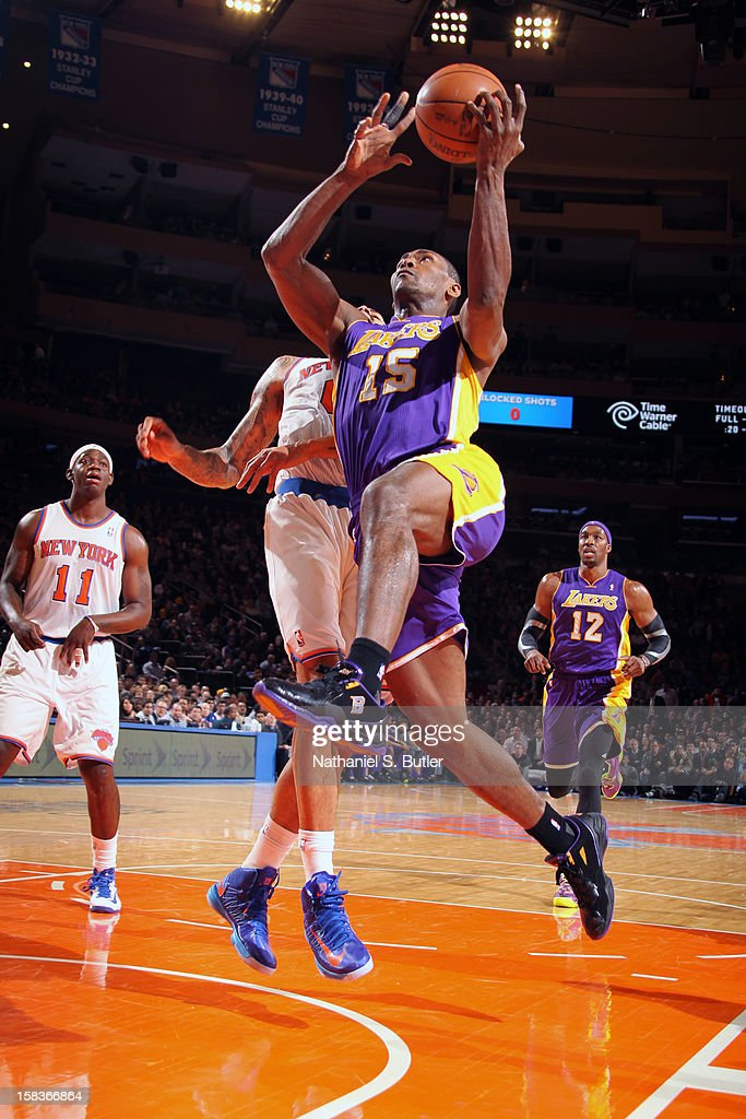 Metta World Peace #15 of the Los Angeles Lakers drives to the basket against the New York Knicks on December 13, 2012 at Madison Square Garden in New York City.