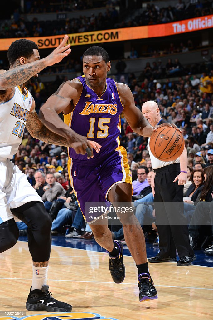 Metta World Peace #15 of the Los Angeles Lakers drives to the basket against the Denver Nuggets on February 25, 2013 at the Pepsi Center in Denver, Colorado.