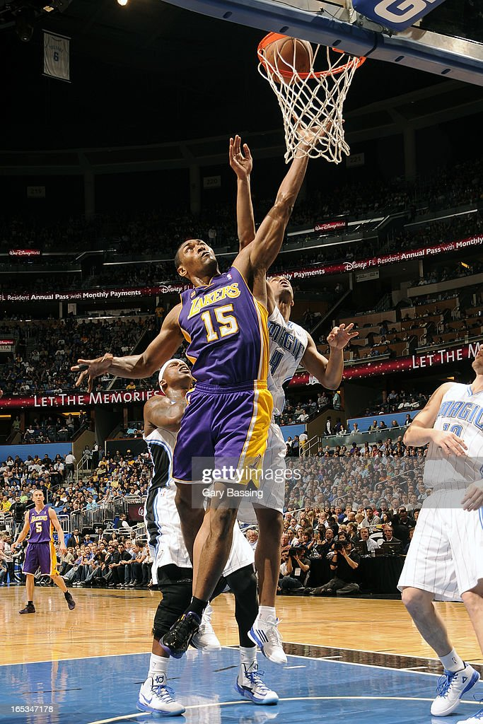 Metta World Peace #15 of the Los Angeles Lakers drives to the basket against the Orlando Magic on March 12, 2013 at Amway Center in Orlando, Florida.