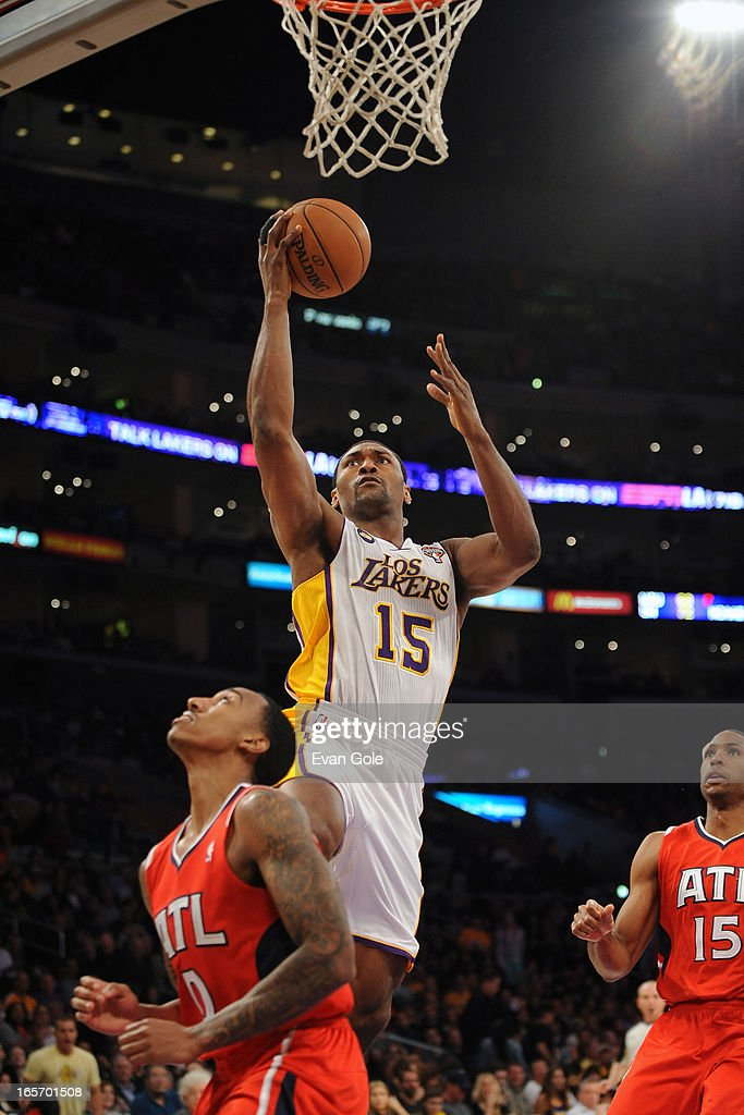 Metta World Peace #15 of the Los Angeles Lakers drives to the basket against the Atlanta Hawks at Staples Center on March 3, 2013 in Los Angeles, California.