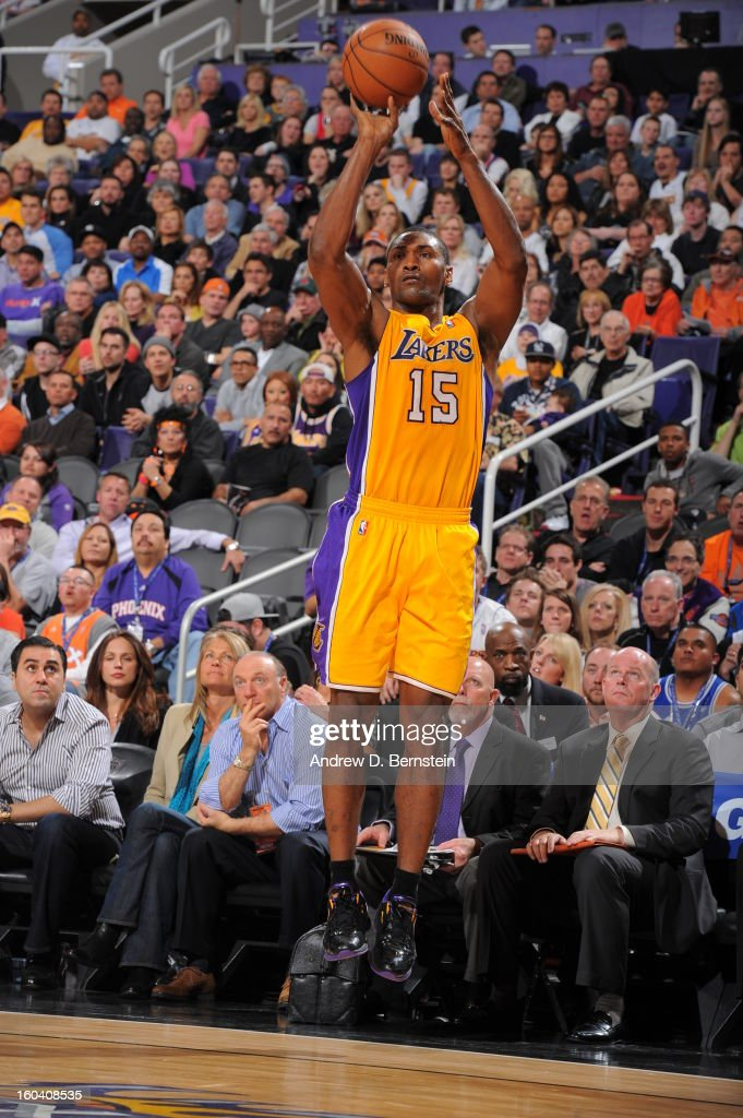 Metta World Peace #15 of the Los Angeles Lakers goes for a jump shot during the game between the Los Angeles Lakers and the Phoenix Suns at US Airways Center on January 30, 2013 in Phoenix, Arizona.