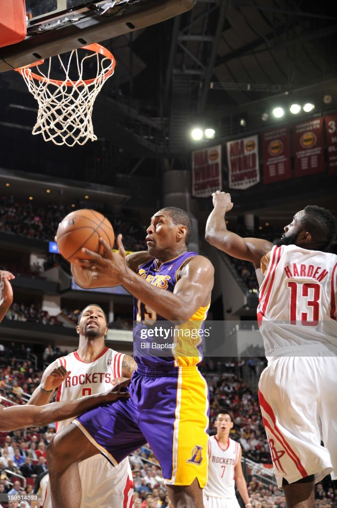 Metta World Peace #15 of the Los Angeles Lakers goes to the basket against Marcus Morris #2 and <a gi-track='captionPersonalityLinkClicked' href=/galleries/search?phrase=James+Harden&family=editorial&specificpeople=4215938 ng-click='$event.stopPropagation()'>James Harden</a> #13 of the Houston Rockets on January 8, 2013 at the Toyota Center in Houston, Texas.