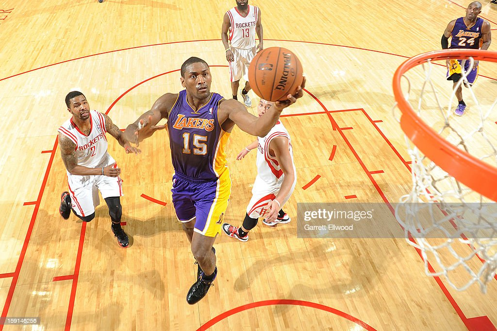 Metta World Peace #15 of the Los Angeles Lakers goes to the basket against Marcus Morris #2 of the Houston Rockets on January 8, 2013 at the Toyota Center in Houston, Texas.