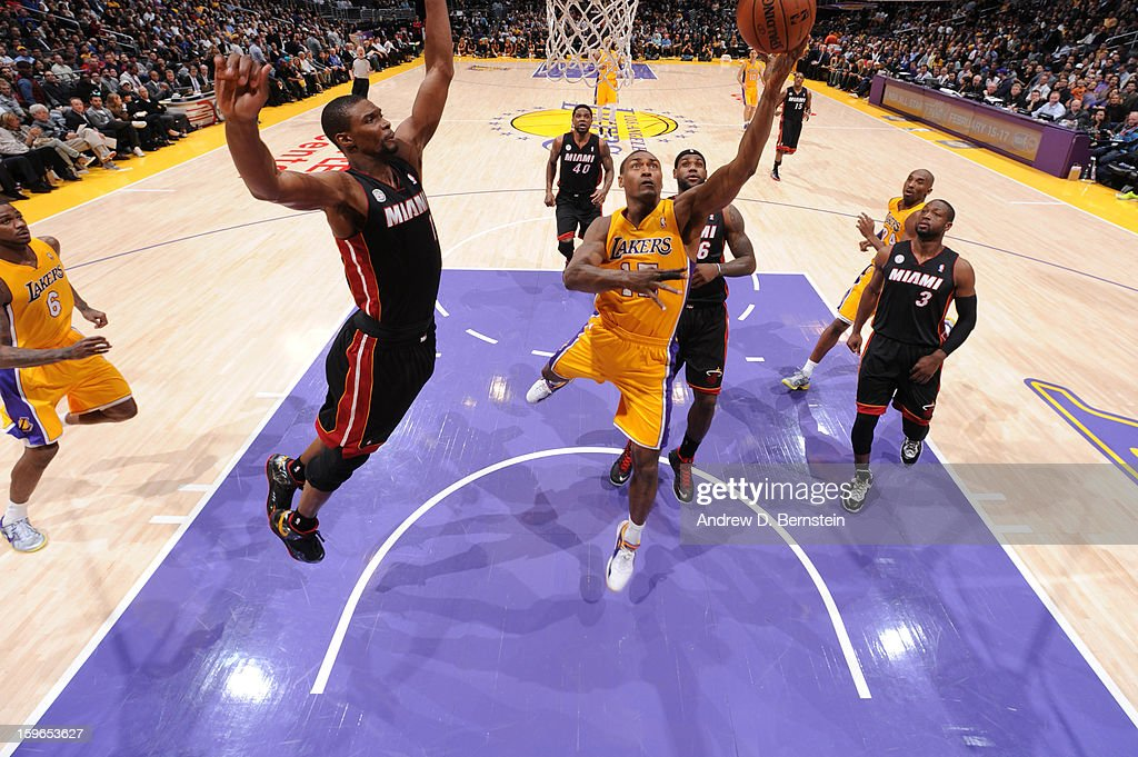 Metta World Peace #15 of the Los Angeles Lakers goes up for a shot against Chris Bosh #1 of the Miami Heat at Staples Center on January 15, 2013 in Los Angeles, California.