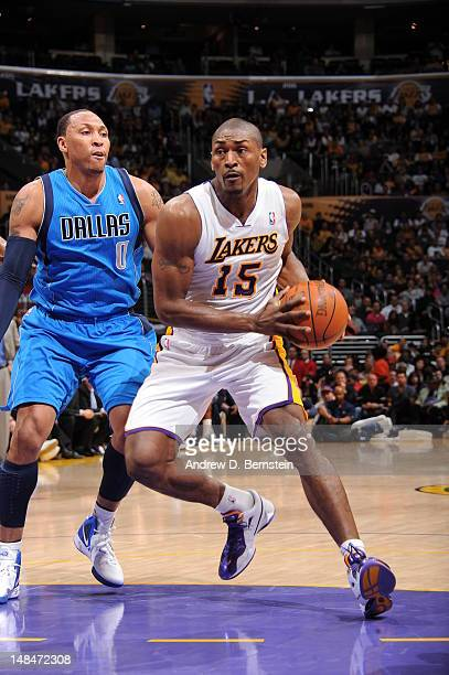 Metta World Peace of the Los Angeles Lakers handles the ball against Shawn Marion of the Dallas Mavericks on April 15 2012 in Los Angeles California...