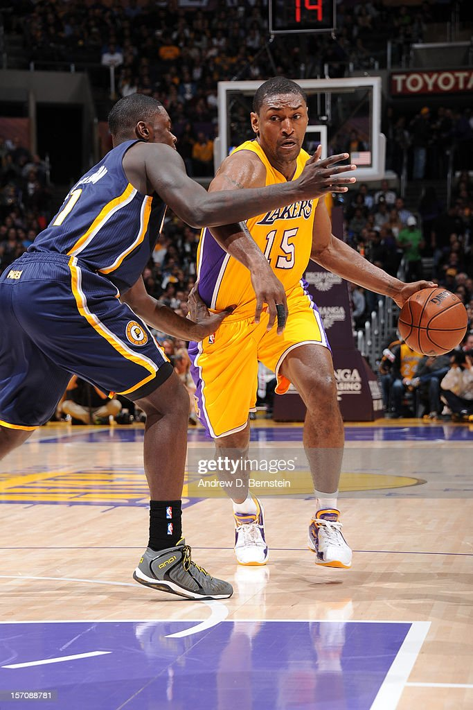 Metta World Peace #15 of the Los Angeles Lakers handles the ball against the <a gi-track='captionPersonalityLinkClicked' href=/galleries/search?phrase=Lance+Stephenson&family=editorial&specificpeople=5298304 ng-click='$event.stopPropagation()'>Lance Stephenson</a> #1 of the Indiana Pacers at Staples Center on November 27, 2012 in Los Angeles, California.