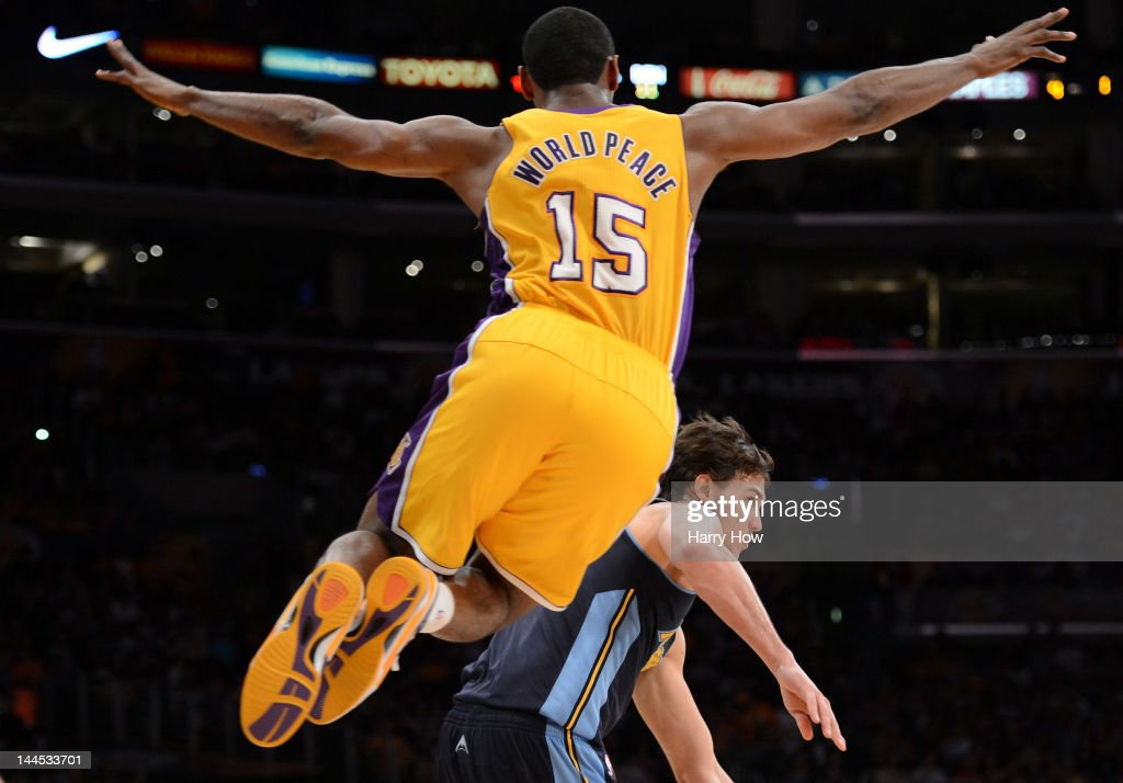 Metta World Peace of the Los Angeles Lakers leaps in the air as he guards Danilo Gallinari of the Denver Nuggets in Game Seven of the Western...