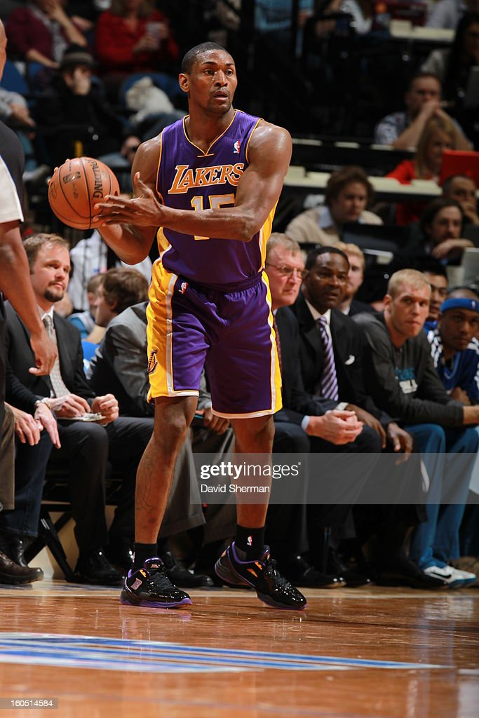 Metta World Peace #15 of the Los Angeles Lakers looks to pass the ball against the Minnesota Timberwolves during the game on February 1, 2013 at Target Center in Minneapolis, Minnesota.