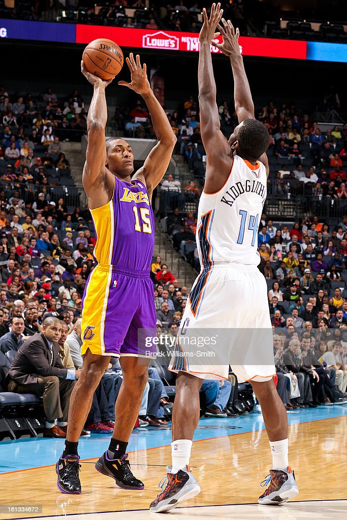 Metta World Peace #15 of the Los Angeles Lakers looks to pass the ball against Michael Kidd-Gilchrist #14 of the Charlotte Bobcats at Time Warner Cable Arena on February 8, 2013 in Charlotte, North Carolina.