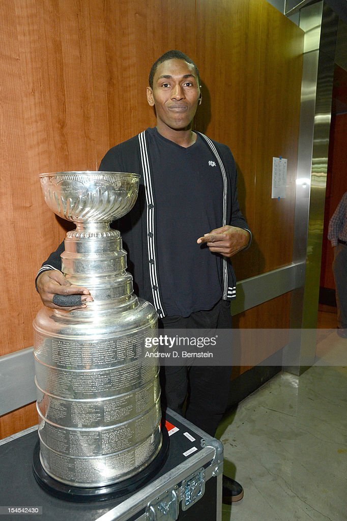 Metta World Peace #15 of the Los Angeles Lakers poses with the Stanley Cup following a game against the Sacramento Kings at Staples Center on October 21, 2012 in Los Angeles, California.