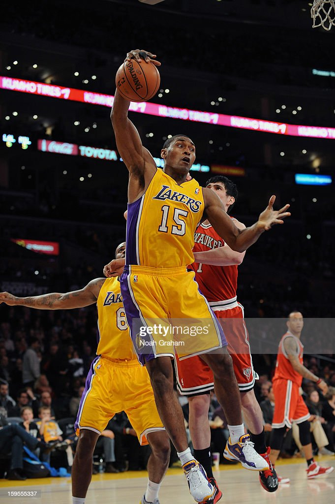 Metta World Peace #15 of the Los Angeles Lakers pulls down a rebound against the Milwaukee Bucks at Staples Center on January 15, 2013 in Los Angeles, California.