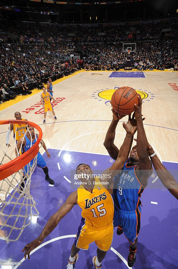 Metta World Peace #15 of the Los Angeles Lakers reaches for a rebound against Serge Ibaka #9 of the Oklahoma City Thunder at Staples Center on January 11, 2013 in Los Angeles, California.