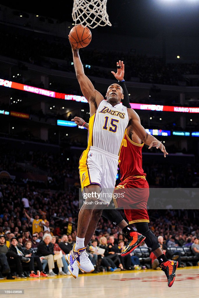 Metta World Peace #15 of the Los Angeles Lakers rises for a dunk against the Cleveland Cavaliers at Staples Center on January 13, 2013 in Los Angeles, California.