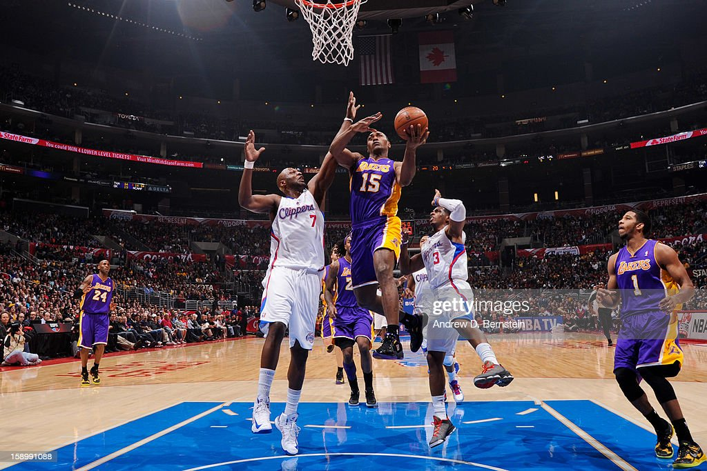 Metta World Peace #15 of the Los Angeles Lakers shoots a layup against Lamar Odom #7 of the Los Angeles Clippers at Staples Center on January 4, 2013 in Los Angeles, California.