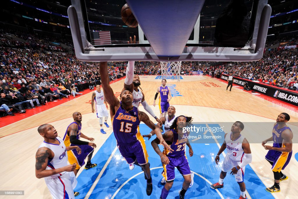 Metta World Peace #15 of the Los Angeles Lakers shoots a layup against Ronny Turiaf #21 of the Los Angeles Clippers at Staples Center on January 4, 2013 in Los Angeles, California.