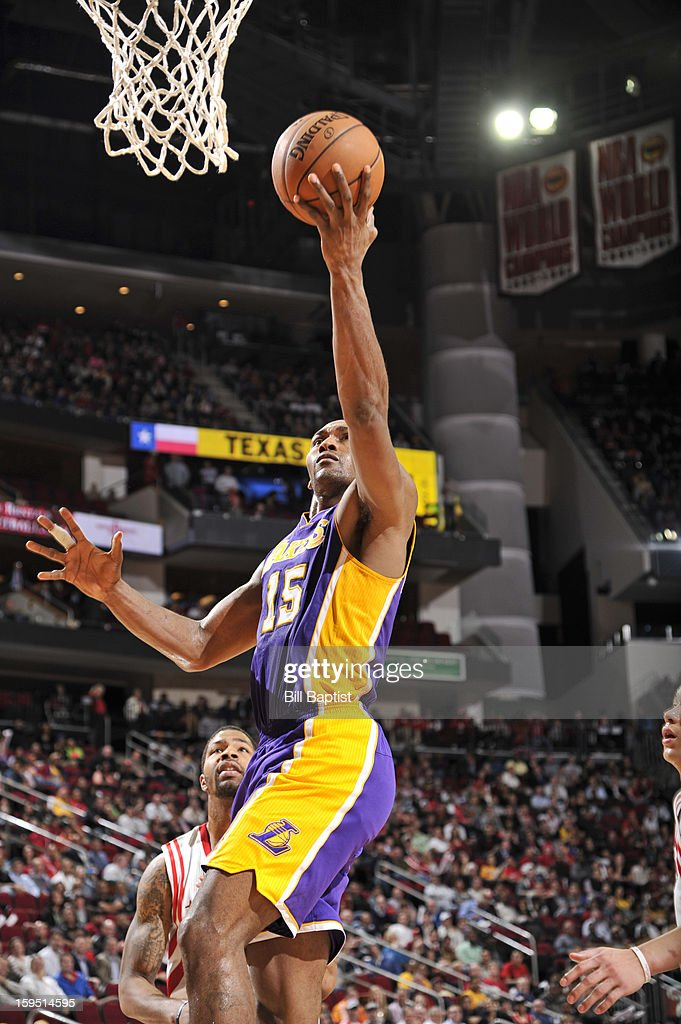 Metta World Peace #15 of the Los Angeles Lakers shoots a layup against the Houston Rockets on January 8, 2013 at the Toyota Center in Houston, Texas.