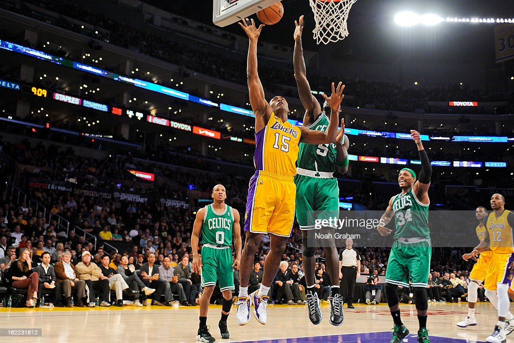 Metta World Peace #15 of the Los Angeles Lakers shoots a layup against Kevin Garnett #5 of the Boston Celtics at Staples Center on February 20, 2013 in Los Angeles, California.