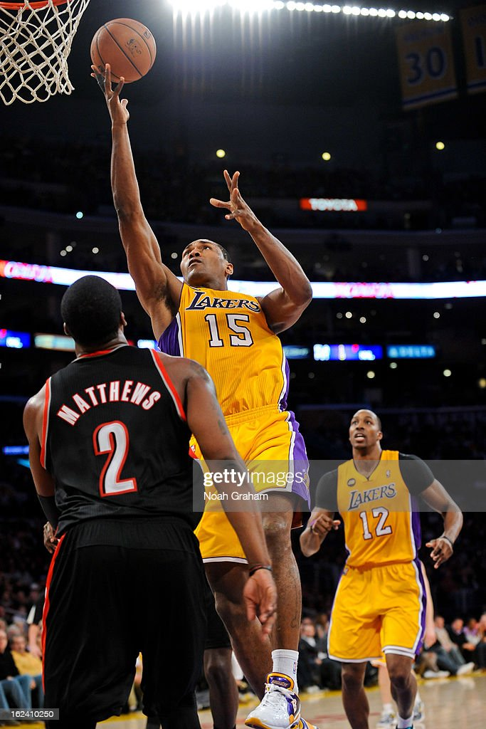 Metta World Peace #15 of the Los Angeles Lakers shoots a layup against <a gi-track='captionPersonalityLinkClicked' href=/galleries/search?phrase=Wesley+Matthews&family=editorial&specificpeople=804816 ng-click='$event.stopPropagation()'>Wesley Matthews</a> #2 of the Portland Trail Blazers at Staples Center on February 22, 2013 in Los Angeles, California.