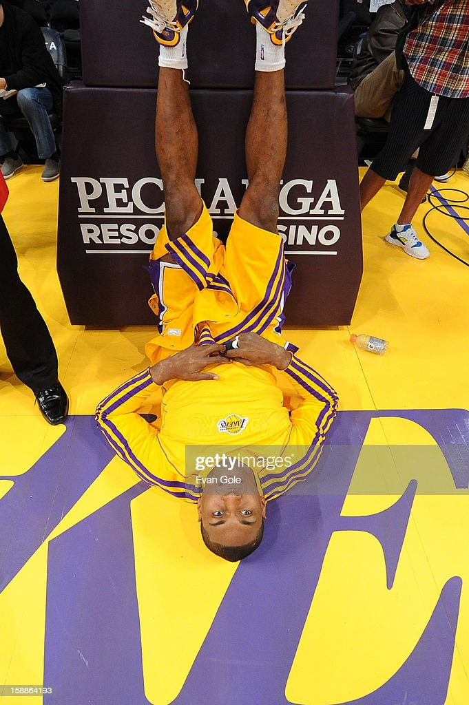 Metta World Peace #15 of the Los Angeles Lakers stretches before the game between the Philadelphia 76ers and the Los Angeles Lakers at Staples Center on January 1, 2013 in Los Angeles, California.